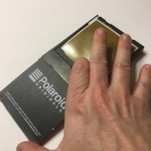 After extracting your sheet film and laying it face up on the trimmer, make sure to place the darkslide back atop the remaining exposures.