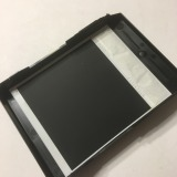 You can then place your film snugly in the well of the disassembled pack film holder. Make sure the front face of the print faces outward - the puffy chemistry pod should be facing inward.